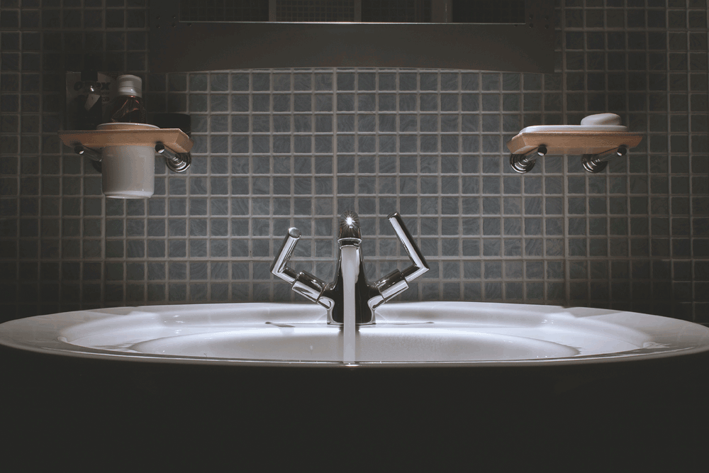 Picture of modern bathroom taps with atmospheric lighting