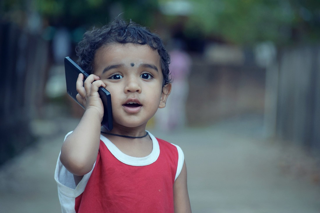 Picture of boy on smart phone