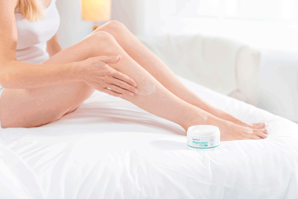 Picture of woman rubbing magnesium cream onto her leg
