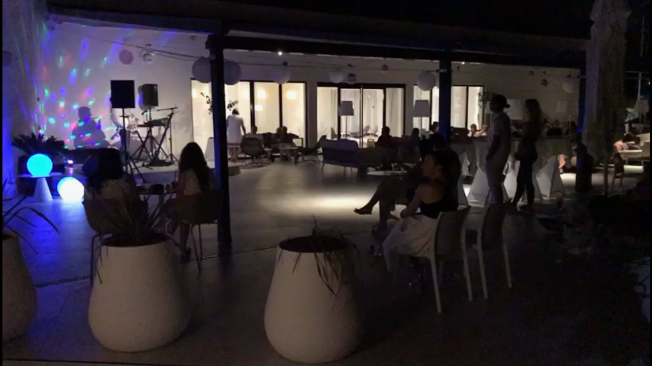 Picture of the mojitio terrace at night with entertainment - Sensimar Adriatic Beach Croatia Review
