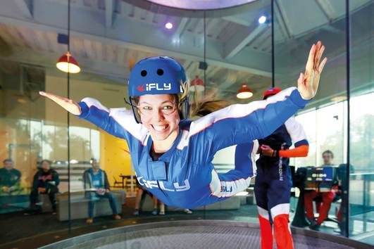 Picture of woman indoor skydiving