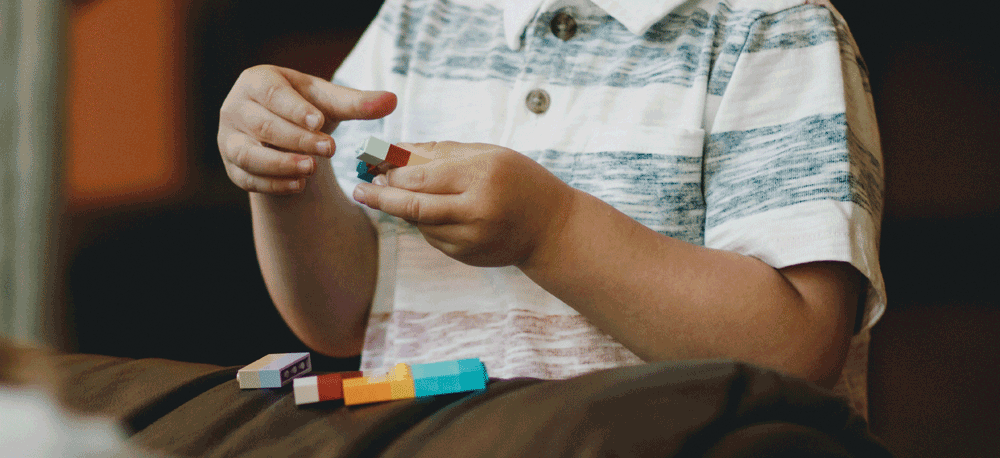 Picture of a boy playing with lego